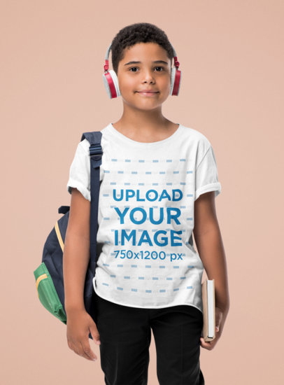 T-Shirt Mockup of a Kid with School Articles Standing at a Studio 44445-r-el2