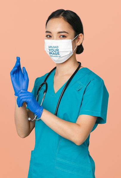 Face Mask Mockup of a Female Nurse Wearing Latex Gloves at a Studio 44524-r-el2