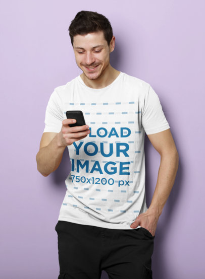 T-Shirt Mockup of a Man Checking His Phone in a Studio 40087-r-el2