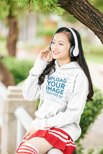 Mockup of a Teenager Wearing a Heathered Hoodie While Sitting in the Park 44476-r-el2