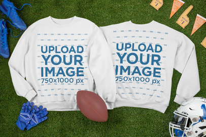 Mockup of Two Crewneck Sweatshirts Laid Next to Football Equipment m327