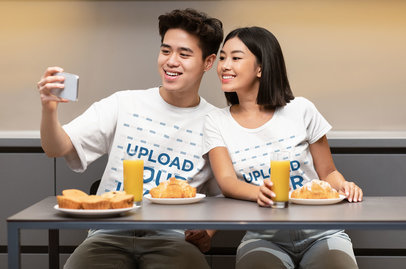 T-Shirt Mockup of a Happy Couple Taking a Selfie While Having Breakfast 44820-r-el2