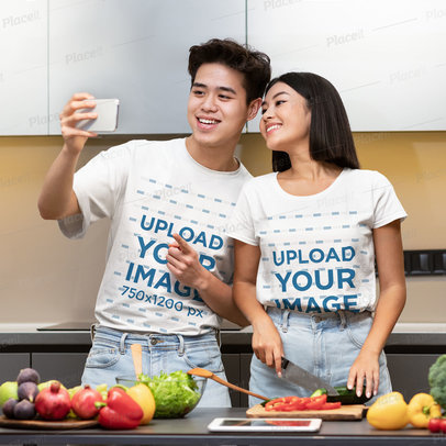 T-Shirt Mockup Featuring a Couple Taking a Selfie While Cooking 44818-r-el2