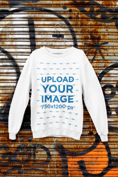 Mockup of a Crewneck Sweatshirt Hanging Against a Rusty Surface m450