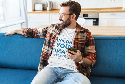 T-Shirt Mockup of a Bearded Man Sitting on a Couch 43951-r-el2