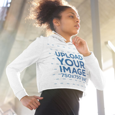 Mockup of a Woman Wearing a Crop Top Hoodie While Jogging 38101-r-el2