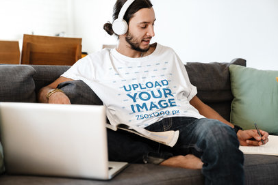 T-Shirt Mockup of a Man with Headphones Writing Notes 44496-r-el2