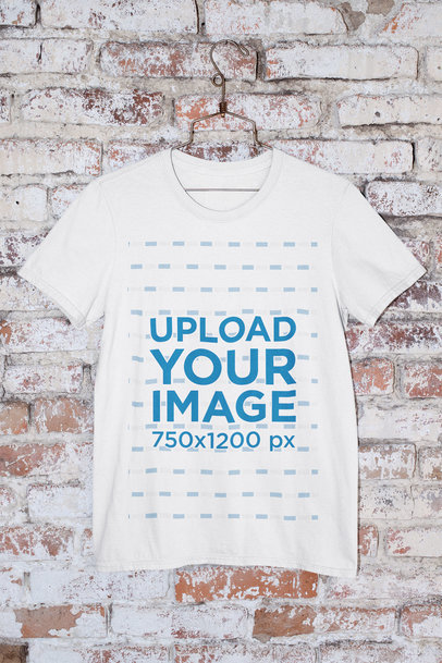 Mockup of a Round Neck T-Shirt Hanged by an Old Brick Wall m437