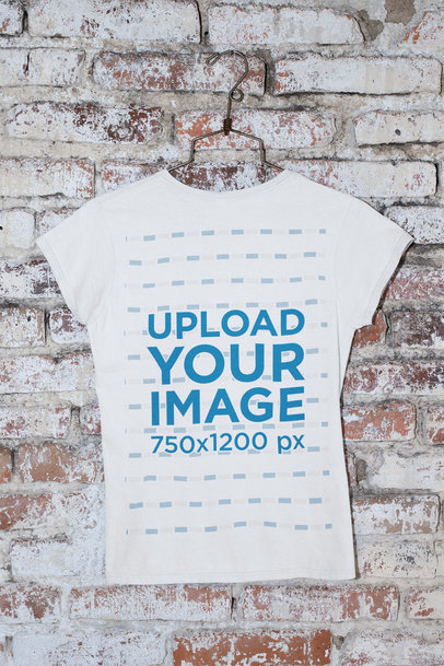 Back-View Mockup of a T-Shirt Hanging Against a Brick Wall m440