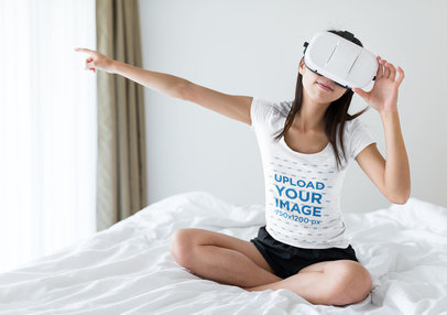 Mockup of a Woman Wearing a T-Shirt and Using a VR Headset in Her Bedroom 44852-r-el2