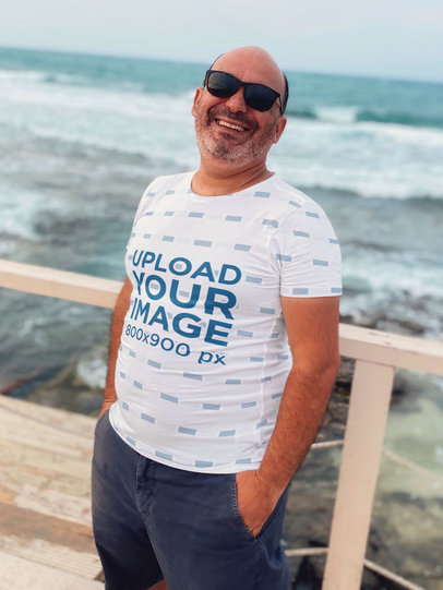 Sublimated T-Shirt Mockup Featuring a Happy Middle-Aged Man Posing by the Beach 45035-r-el2