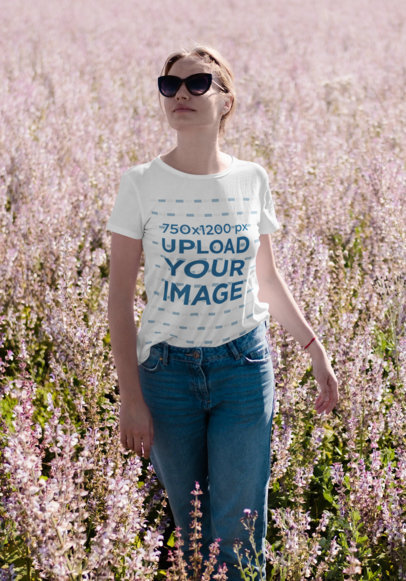 T-Shirt Mockup Featuring a Happy Woman Walking Through a Flower Field 45105-r-el2