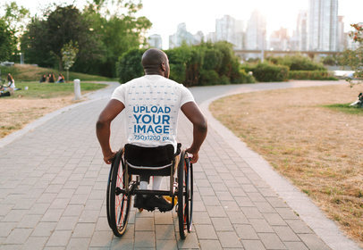 Back-View T-Shirt Mockup Featuring a Man Using a Wheelchair 45092-r-el2