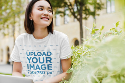 Crop Top Tee Mockup of a Young Woman Sitting by a Bush 44866-r-el2