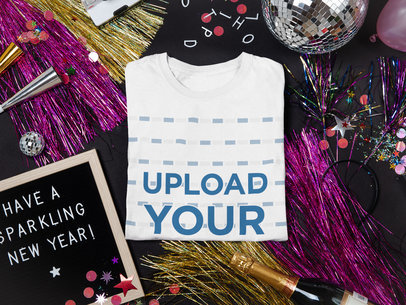 Mockup of a Folded T-Shirt Surrounded by New Year's Party Items m283