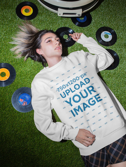 Sweatshirt Mockup of a Woman Lying on the Floor Surrounded by Music Albums m536