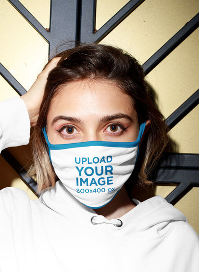 Face Mask Mockup Featuring a Woman and a Hard Light m547