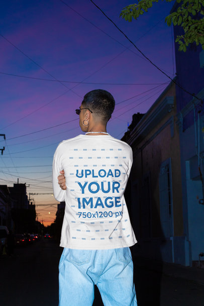 Back View Mockup of Man with a Long-Sleeve Tee Standing on the Street at Night m582