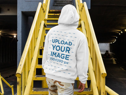 Back View Mockup Featuring a Man Wearing a Hoodie and on a Metal Staircase m526