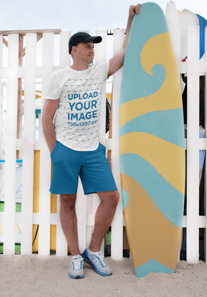 T-Shirt Mockup Featuring a Man Posing with a Surfboard 45325-r-el2
