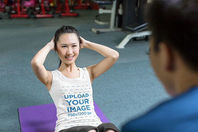Tank Top Mockup of a Woman Doing Abs with a Trainer 41158-r-el2