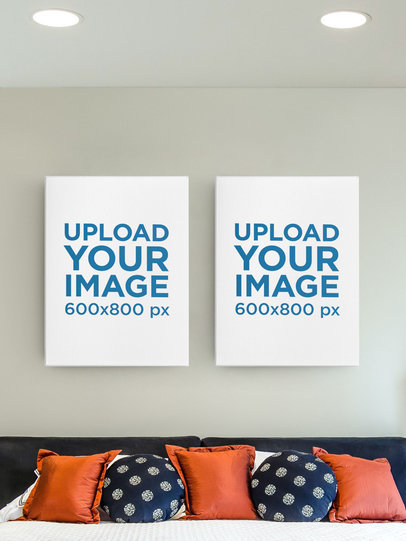 Mockup Featuring Two Framed Art Prints Hanging on a Bedroom's Wall m912