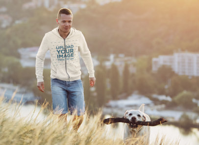 Hoodie Mockup of a Man Hiking Outside of the City with His Dog 45282-r-el2