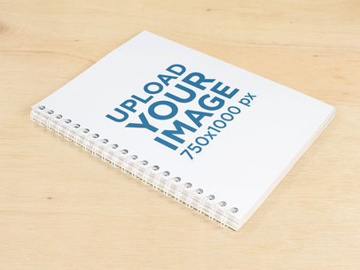 Spiral Notebook Template Lying on a Wooden Surface a14830
