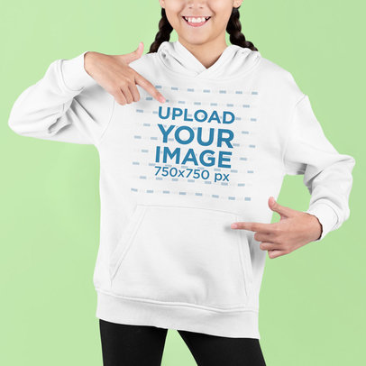 Studio Mockup Featuring a Girl Pointing at Her Hoodie m730