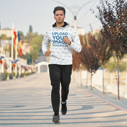Sublimated Hoodie Mockup of a Man Running in the City 45247-r-el2