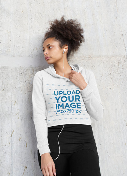 Crop Top Hoodie Mockup of a Serious Woman Listening to Music 45222-r-el2