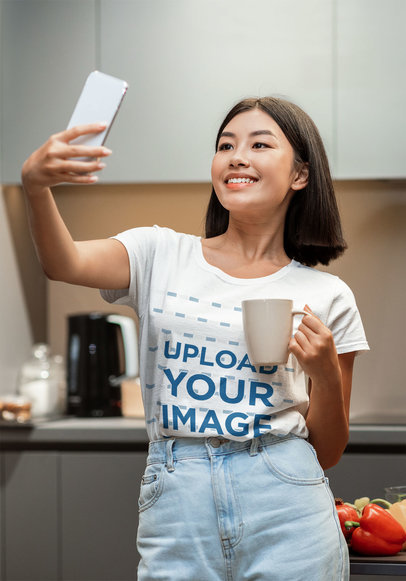 Tee Mockup of a Woman Taking a Selfie at Her Kitchen 45722-r-el2