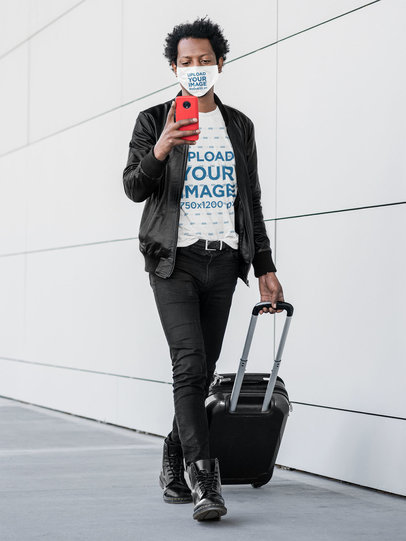 T-Shirt and Face Mask Mockup of a Man Carrying Luggage 45777-r-el2