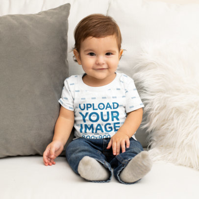 T-Shirt Mockup Featuring a Happy Baby Boy on a Couch M1004
