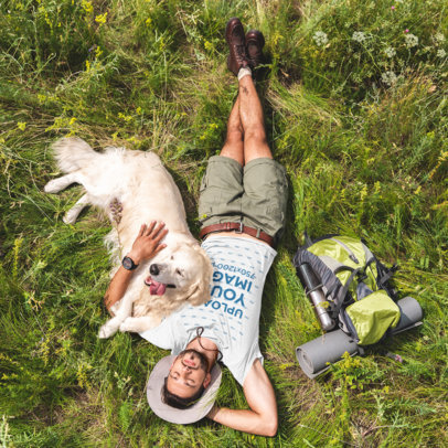 T-Shirt Mockup of a Man Lying on the Grass With His Dog 45981-r-el2