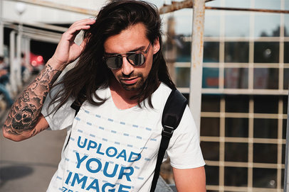 Mockup of a Long-Haired Man With an Arm Tattoo Wearing a V-Neck Tee 43132-r-el2