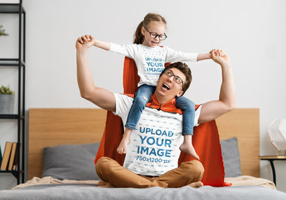 T-Shirt Mockup Featuring a Father Playing Superheroes with His Daughter 39519-r-el2