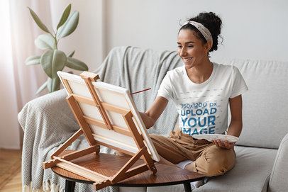 T-Shirt Mockup Featuring a Woman Painting at Home 46132-r-el2