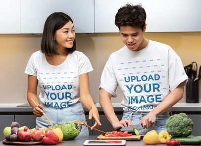 T-Shirt Mockup Featuring a Young Couple Cooking Healthy Food 46117-r-el2