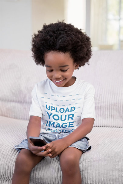 T-Shirt Mockup of a Happy Kid Using a Smartphone 46122-r-el2