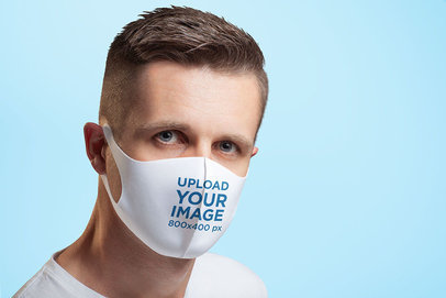 Face Mask Mockup Featuring a Serious Man in a Studio 4988-el1