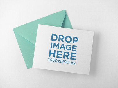 Invitation Card with Envelope Lying Above a Solid Surface a15095
