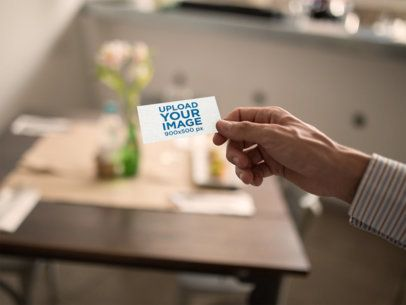 Template of a Man Holding a Business Card at a Restaurant a15009
