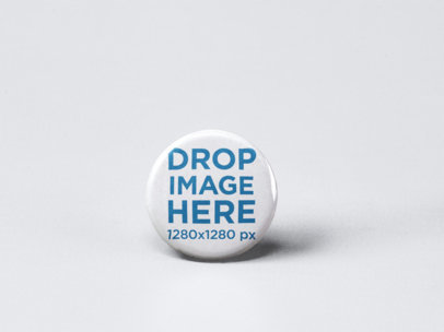 Small Button Mockup Standing on a Solid Surface a15085