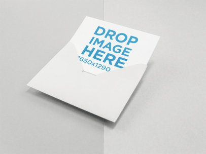 Invitation Coming out of an Envelope Mockup on a Two Colors Surface a15134