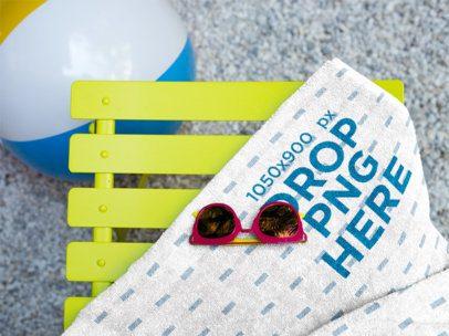 Sunglasses on a Towel Mockup Lying Near a Beach Ball a14898