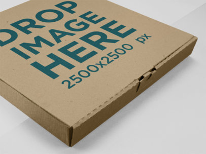 Closeup Mockup of a Pizza Box Lying on a Multicolor Surface a15223