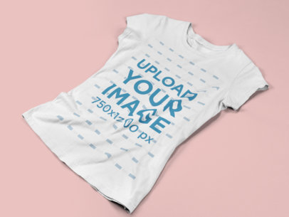 Mockup of a Women's Tshirt Lying on a Flat Surface a15253