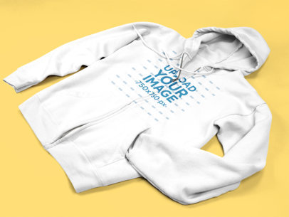 Full Zip Hoodie Mockup Lying on a Flat Surface a15240