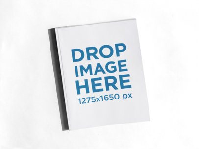 Magazine Floating Over a Solid Color Surface a15296